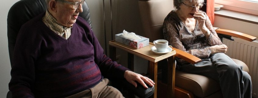 elderly couple sitting next to each other, signs you need assisted living