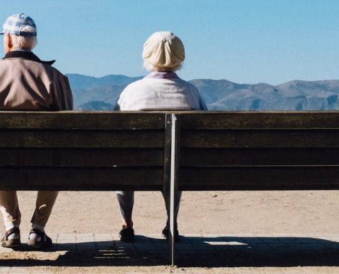 seniors on a bench, assisted living vs memory care