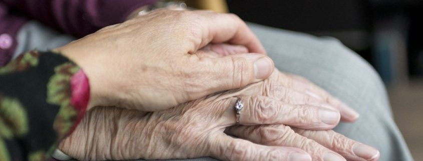 how does dementia affect the brain, woman holding elderly woman's hand